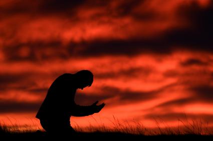 man-kneeling-in-prayer